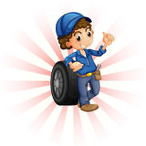 A boy in front of a wheel with a blue cap Royalty Free Stock Images