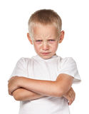 Boy with frowning face Stock Image