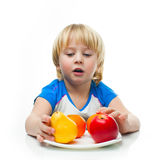 Boy with fruit Stock Images