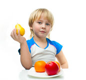 Boy with fruit Royalty Free Stock Photo