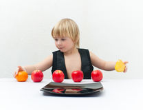 Boy with fruit Royalty Free Stock Photos
