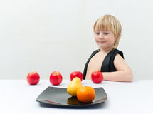 Boy with fruit Stock Photography