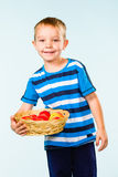 Boy and fruit basket Stock Image