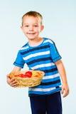 Boy and fruit basket Stock Image