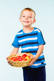 Boy and fruit basket Royalty Free Stock Photography
