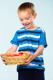 Boy and fruit basket Stock Photo