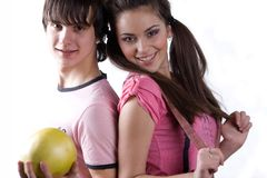 Boy with fruit and girl in pink dress Stock Photo