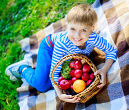Boy with fruit outdoor Royalty Free Stock Photos
