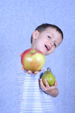 Boy and fruits Stock Image