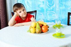 Boy and fruits Stock Photos