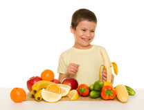Boy with fruits and vegetables Royalty Free Stock Photo