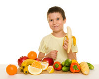 Boy with fruits and vegetables Stock Photography