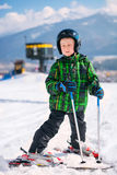 Boy in full ski equipment at the mountain ski resort Stock Images