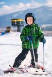 Boy in full ski equipment at the mountain ski resort Stock Images