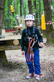 Boy fully equipped in an adventure park Royalty Free Stock Images
