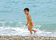 Boy funny beach Stock Photography