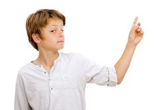 Boy with funny face expression pointing. Royalty Free Stock Images