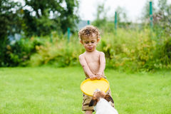 Boy with funny face expression and tongue playing with dog Royalty Free Stock Photos