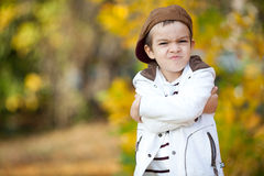 A boy with funny face in the woods Stock Image