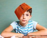 Boy with funny headwear as a creative idea Stock Photo