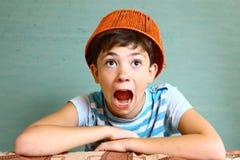 Boy with funny headwear as a creative idea Stock Photography