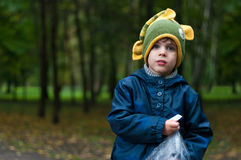 Boy in funny knitted fish hat Royalty Free Stock Photos