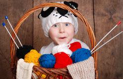 Boy in funny knitting panda hat Royalty Free Stock Image