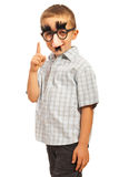 Boy with funny mask pointing Royalty Free Stock Image