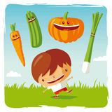Boy with funny vegetables Royalty Free Stock Images