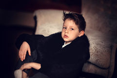 Boy in a fur coat Royalty Free Stock Photos