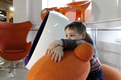 Boy in the furniture store Stock Photography