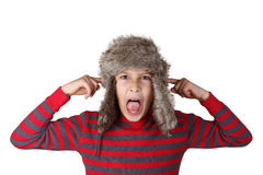 Boy in furry hat pulling funny face Royalty Free Stock Photography