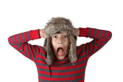 Boy in furry hat with shocked face Stock Image