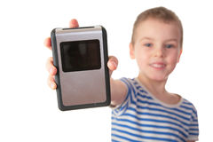 Boy with gadget. On white stock photography