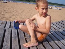Boy with game console. At the beach Stock Images