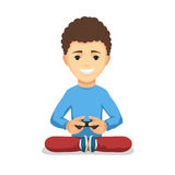 Boy with game controller gamepad. Curly teenager boy with game controller gamepad isolated on the white background. Kid Playing video games keeps the joystick in Royalty Free Stock Photos