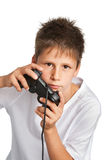 Boy with games controller. Cute boy wearing a white shirt playing on games controller. Studio shot on white background Royalty Free Stock Photo