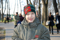 Boy with gap-tooth smile. Happy young boy with gap-tooth smile in the spring park Stock Photos
