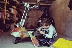 Boy in the garage Royalty Free Stock Images