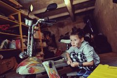 Boy in the garage Stock Photography
