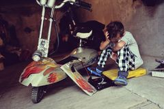 Boy in the garage Stock Images