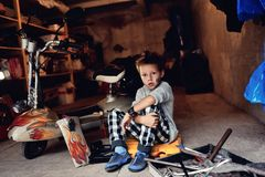 Boy in the garage Royalty Free Stock Image