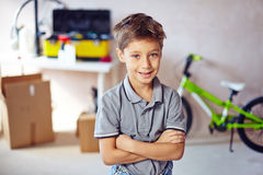 Boy in garage Stock Images