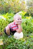 Boy  in the garden Royalty Free Stock Photos