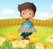 A boy in the garden holding an empty egg tray Stock Photos