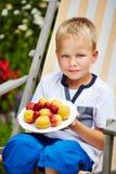 Boy in garden with own harvest Stock Photos