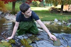 Boy in  garden pond Royalty Free Stock Photos