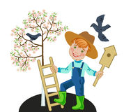 Boy Gardener birdhouse hangs on a tree Royalty Free Stock Photo