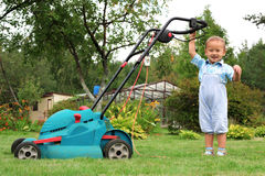 Boy Gardener mowing the lawn Stock Photography