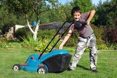 Boy Gardener Mowing The Lawn Stock Photos